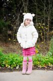 Full length portrait of a child girl in warm hat Royalty Free Stock Images