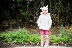 Full length portrait of a child girl in warm hat Stock Photo