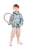 Full length portrait of a child holding a tennis racket. Isolated on white background Stock Images