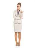 Full length portrait of concerned business woman Royalty Free Stock Photos