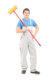 Full length portrait of a confident cleaner in a uniform with a Royalty Free Stock Images
