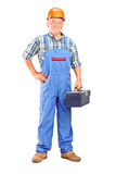 Full length portrait of a confident manual worker holding a tool Stock Images