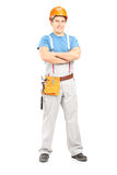 Full length portrait of a confident repairman in a uniform Royalty Free Stock Images