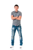 Full length portrait of a confident young man with arms crossed. Full length portrait of a confident young man on isolated white background with arms crossed Royalty Free Stock Photos