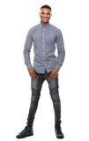 Full length portrait of a cool black guy smiling. On isolated white background stock photography
