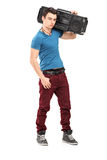 Full length portrait of a cool guy with a radio. Isolated on white background stock photos