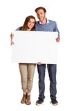 Full length portrait of couple with blank board Stock Photos