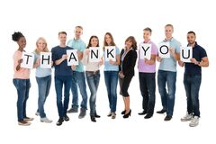 Creative Business People Holding Thank You Sign