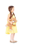 Full length portrait of cute child holding a teddy bear Stock Photography
