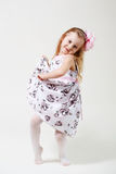 Full length portrait of a cute little blonde girl dancing Stock Photography