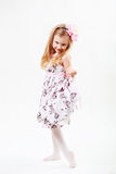 Full length portrait of a cute little blonde girl dancing Stock Photos