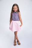 Full length portrait of a cute smiling little girl Royalty Free Stock Image