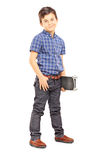 Full length portrait of a cute young boy holding a skateboard. Isolated on white background Stock Image