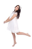 Full length portrait of cute young woman in white dress with flo Royalty Free Stock Images