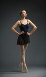 Full-length portrait of dancing ballerina with hands on hips Stock Images
