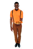 Full length portrait of delivery boy with pizza Stock Photos
