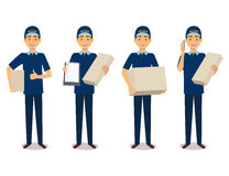 Full length portrait of delivery man in blue uniform holding box Royalty Free Stock Photography