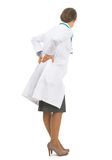 Full length portrait of doctor woman with back pain Royalty Free Stock Photography