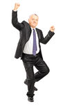 Full length portrait of an ecstatic businessman with hands in th Stock Image