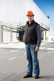 Full length portrait of engineer posing against big warehouse Royalty Free Stock Photos