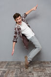 Full length portrait of excited dancing young man Royalty Free Stock Photo