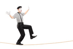 Full length portrait of an excited male mime artist walking on a Stock Image