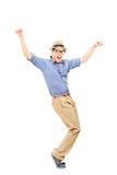 Full length portrait of an excited man dancing. Isolated on white background royalty free stock images
