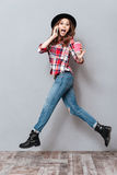 Full length portrait of an excited woman in plaid shirt Stock Photos