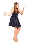 Full length portrait of an excited young female Stock Photography