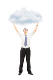 Full length portrait of an excited young man holding a cloud Stock Images