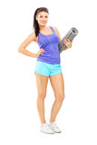Full length portrait of a female athlete  listening music and ho Royalty Free Stock Photos