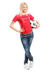 Full length portrait of a female football fan holding a ball Royalty Free Stock Image