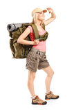 Full length portrait of a female hiker looking up Royalty Free Stock Images