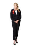 Full Length Portrait Of Female Politician Wearing Red Rosette Royalty Free Stock Photos