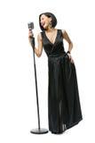 Full-length portrait of female singer Stock Photography