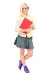 Full length portrait of a female student holding books Stock Photos