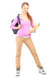 Full length portrait of a female student holding holding backpac. K and book isolated on white background Royalty Free Stock Photos