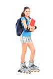 Full length portrait of a female student on roller skates Royalty Free Stock Photo