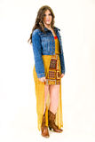 Full Length Portrait Female Teen. Young girl blue jean jacket and yellow print short skirt, brown cowboy boots Royalty Free Stock Photos