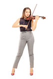 Full length portrait of a female violinist Stock Photo