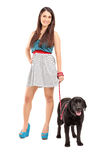 Full length portrait of a female walking her dog Stock Image