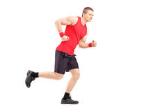 Full length portrait of a fit muscular male athlete running. On white background Stock Photography