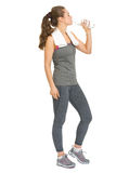 Full length portrait of fit woman drinking water Stock Photos
