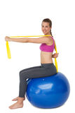 Full length portrait of fit woman exercising on fitness ball Royalty Free Stock Photo