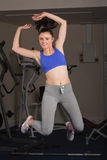 Full length portrait of fit woman jumping in gym Stock Images