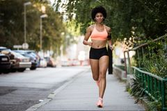 Full length portrait of a fit woman runner Stock Photo