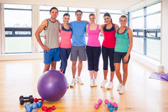 Full length portrait of fitness class at exercise room Royalty Free Stock Images