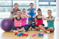 Full length portrait of fitness class gesturing thumbs up Stock Photography