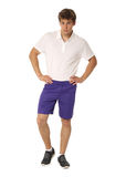 Full length portrait of a fitness man in blue shorts isolated Royalty Free Stock Photos