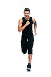 Full length portrait of a fitness man running Stock Image